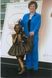 Shirley Temple with statue